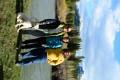 John, Caroline, and George on the river bank